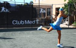 junior tennis player swinging at tennis camp